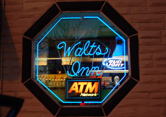 Our neon sign lighting the night